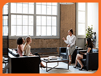 Women talking in a conference room