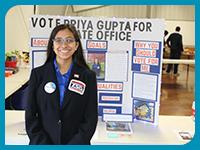 Priya Gupta presenting her poster