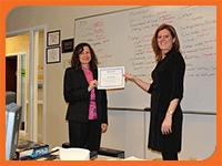Rachel Hopkins holding certificate